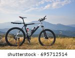 bicycle on the mountain.... | Shutterstock . vector #695712514