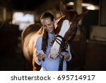 female vet using mobile phone... | Shutterstock . vector #695714917