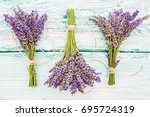 lavender herbs on the wooden... | Shutterstock . vector #695724319