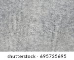 gray knitted carpet closeup.... | Shutterstock . vector #695735695