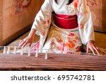 woman in kimono dress is... | Shutterstock . vector #695742781