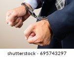 arrested businessman in... | Shutterstock . vector #695743297