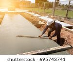 man hand spreading concrete mix ... | Shutterstock . vector #695743741