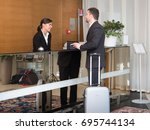 businessman is arrived in hotel ... | Shutterstock . vector #695744134