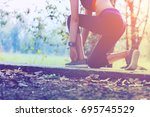 woman doing exercises and warm... | Shutterstock . vector #695745529