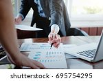 working business people analyse ... | Shutterstock . vector #695754295