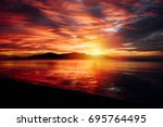 gloomy tropical sunset sunrise... | Shutterstock . vector #695764495