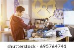 boy builds fully functional... | Shutterstock . vector #695764741