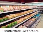 fresh chicken meat on... | Shutterstock . vector #695776771