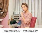 girl in hair salon  magazine....   Shutterstock . vector #695806159