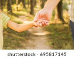 the parent holding the child's... | Shutterstock . vector #695817145