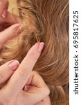 female hands and hair  macro.... | Shutterstock . vector #695817625