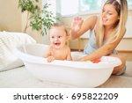 baby bathing in the bathroom... | Shutterstock . vector #695822209