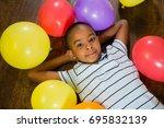 overhead view of cute boy... | Shutterstock . vector #695832139