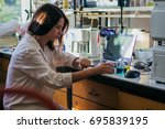 young female laboratory... | Shutterstock . vector #695839195
