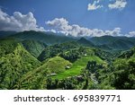 green rice fields in the... | Shutterstock . vector #695839771