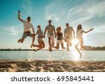 friends jumping on the beach... | Shutterstock . vector #695845441