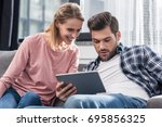 young happy couple using... | Shutterstock . vector #695856325