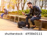 a handsome young hipster man... | Shutterstock . vector #695860111
