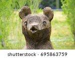 Wooden Sculpture Of A Bear In...