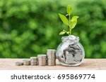 stack of coins and jar with... | Shutterstock . vector #695869774