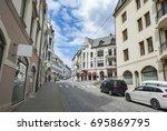 street in alesund in norway in... | Shutterstock . vector #695869795