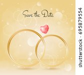 wedding background with rings... | Shutterstock .eps vector #695879554