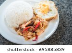 thai food   crispy fried pork... | Shutterstock . vector #695885839