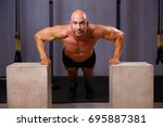 strong ripped bald man work out.... | Shutterstock . vector #695887381