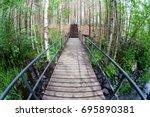 suspension bridge in the park. | Shutterstock . vector #695890381
