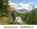 girl  tourist  on a rock.  | Shutterstock . vector #695893615