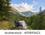 girl  tourist  on a rock.  | Shutterstock . vector #695893621