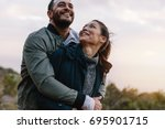 romantic young couple embracing ... | Shutterstock . vector #695901715