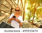 a beautiful young blonde woman... | Shutterstock . vector #695915674