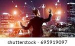 back view of businesswoman... | Shutterstock . vector #695919097