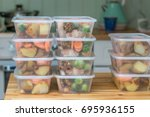 meal prep. stack of home cooked ... | Shutterstock . vector #695936155