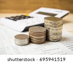 stack of coins over account... | Shutterstock . vector #695941519