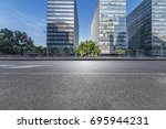 empty road with modern business ... | Shutterstock . vector #695944231