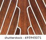 wet teak wood deck on boat ... | Shutterstock . vector #695945071