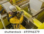 working at height. a commercial ... | Shutterstock . vector #695946379