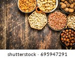 various nuts in bowls. on... | Shutterstock . vector #695947291