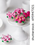 cupcakes decorated using... | Shutterstock . vector #695947321