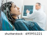 Stock photo charming young woman undergoing electroencephalography 695951221