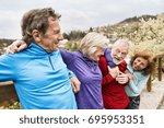 group of senior runners posing... | Shutterstock . vector #695953351