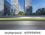 empty road with modern business ... | Shutterstock . vector #695954044