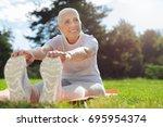 Joyful Mature Woman Stretching...