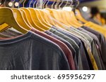 t shirt for the man on hangers...   Shutterstock . vector #695956297