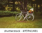white bicycle with flowers in... | Shutterstock . vector #695961481