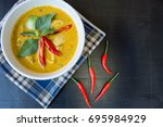 green curry with chicken on... | Shutterstock . vector #695984929