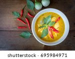 green curry with chicken on... | Shutterstock . vector #695984971